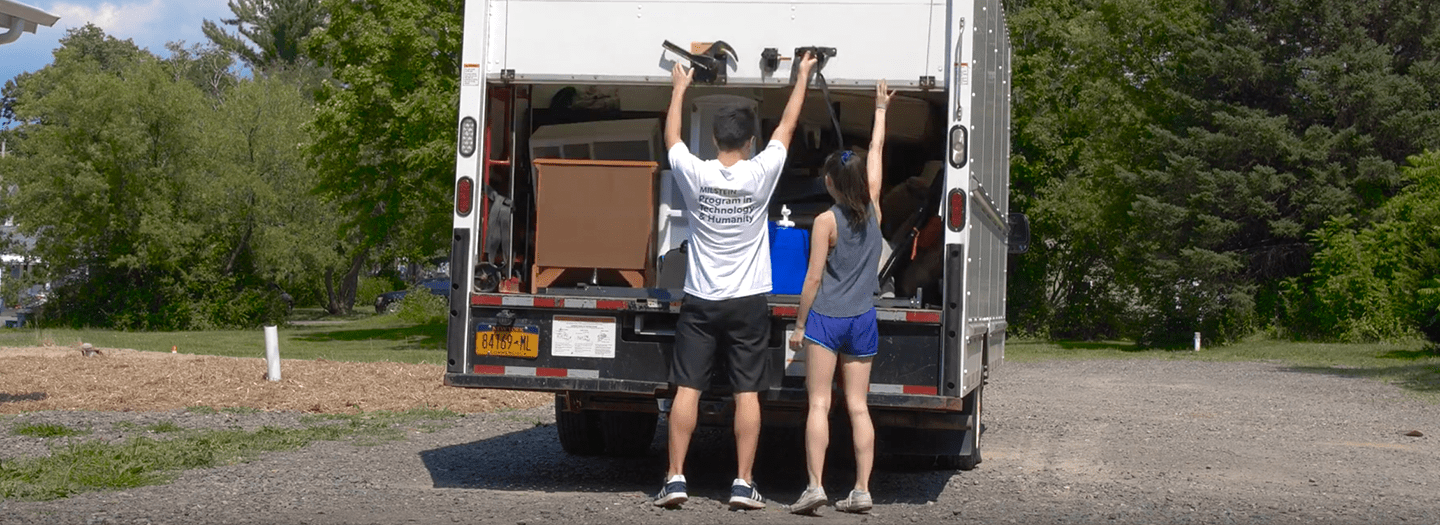 Milstein Students working with Neighbor to Neighbor delivery furniture to person moving out of homelessness