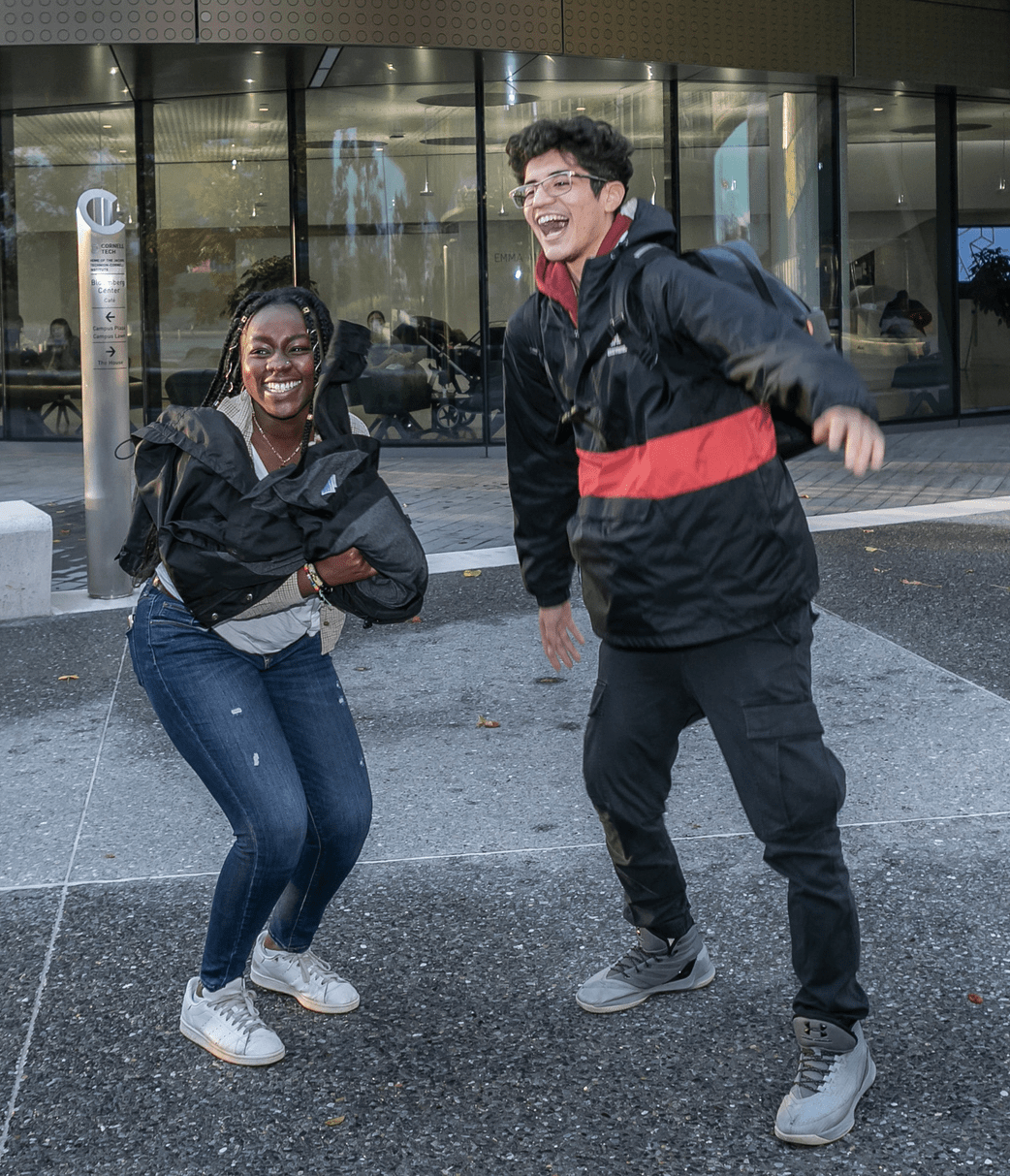 Milstein students jumping in the air at Cornell Tech